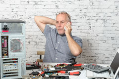 A technician repairing a computer. With different tools Stock Photo