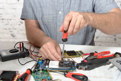 A technician repairing a computer. With different tools Stock Images