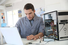 Technician repairing the computer Stock Photography