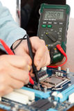 Technician repairing computer hardware Stock Image
