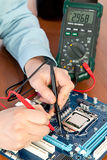 Technician repairing computer hardware Stock Photo
