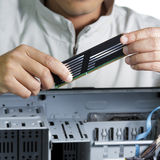 Technician repairing computer hardware Stock Photos