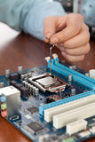 Technician repairing computer hardware in the lab. Studio shot. Small DOF Royalty Free Stock Photography