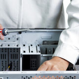 Technician repairing computer hardware Stock Images