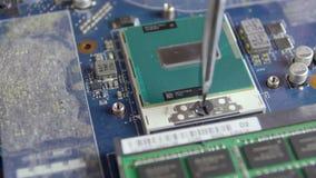 Technician is repairing computer using screwdriver.  stock footage