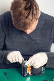 Technician repairing digital camera Stock Images