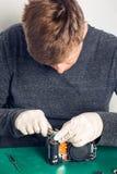 Technician repairing digital camera Stock Images