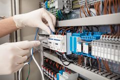 Technician repairing fusebox Royalty Free Stock Photos