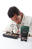 Technician repairing a hard disk Royalty Free Stock Image
