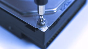 Technician are repairing a harddisk by using a screwdriver to close, assembled a part of drive back again stock video