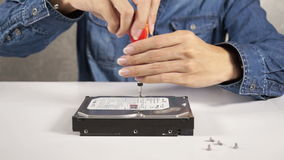 Technician are repairing a harddisk by using a screwdriver stock footage