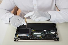 Technician Repairing Laptop Stock Image