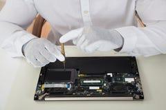 Technician Repairing Laptop Stock Image
