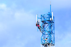Technician repairing on telecommunication tower Royalty Free Stock Images