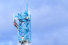 Technician repairing on telecommunication tower Stock Images