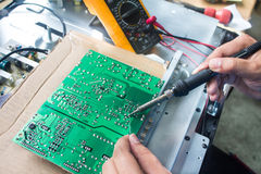 Technician repairing  a television. Technician repairing power board a television Royalty Free Stock Photo