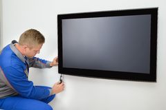 Technician repairing television Royalty Free Stock Photos