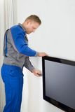 Technician repairing television Stock Photos