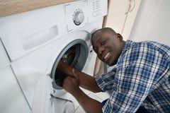 Technician Repairing Washing Machine Stock Photos
