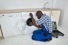 Technician Repairing Washing Machine Stock Images