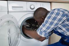 Technician Repairing Washing Machine Stock Photo