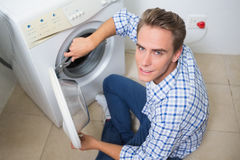 Technician repairing a washing machine Royalty Free Stock Photo
