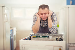 Technician repairing a washing machine Royalty Free Stock Photography