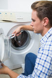Technician repairing a washing machine Stock Image