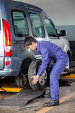 Technician Replacing Car Tire Royalty Free Stock Photo