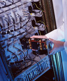 IT Technician replacing a circuit board Royalty Free Stock Images