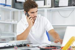 Technician reqesting help from hq Stock Photos
