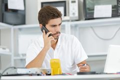 Technician reqesting help from hq Royalty Free Stock Photo