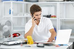Technician reqesting help from hq Royalty Free Stock Image
