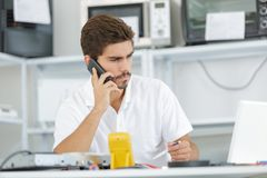Technician reqesting help from hq Stock Images