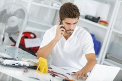 Technician reqesting help from hq Stock Image