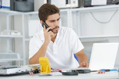 Technician reqesting help from hq Stock Photo