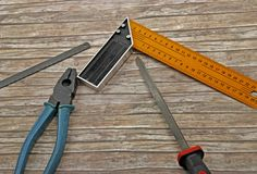 Technician's tools on old wood Royalty Free Stock Photography