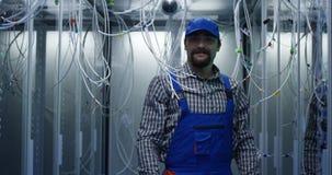 Technician searching through cables. Medium shot of a technician searching through cables at a data center stock photo