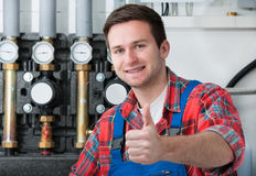Technician servicing heating boiler Stock Images