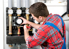 Technician servicing heating boiler Royalty Free Stock Images