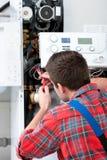 Technician servicing heating boiler Stock Photos