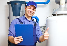 Technician servicing an hot-water heater Royalty Free Stock Photo