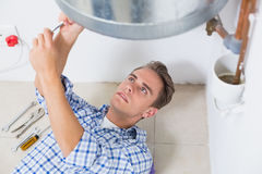 Technician servicing an hot water heater Royalty Free Stock Photos
