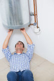 Technician servicing an hot water heater Stock Photos