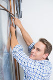 Technician servicing an hot water heater' pipes Stock Image