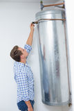 Technician servicing an hot water heater Stock Photo