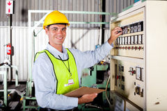 Technician setting machine. Male caucasian technician seeting up industrial machine Royalty Free Stock Photography
