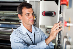 Technician setting machine Stock Photos