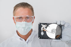 Technician Showing Hard Drive Stock Image
