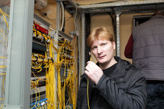 Technician showing patch cord Royalty Free Stock Image